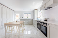 Stunning White Marble Floor Kitchen with White Cabinets and Countertops