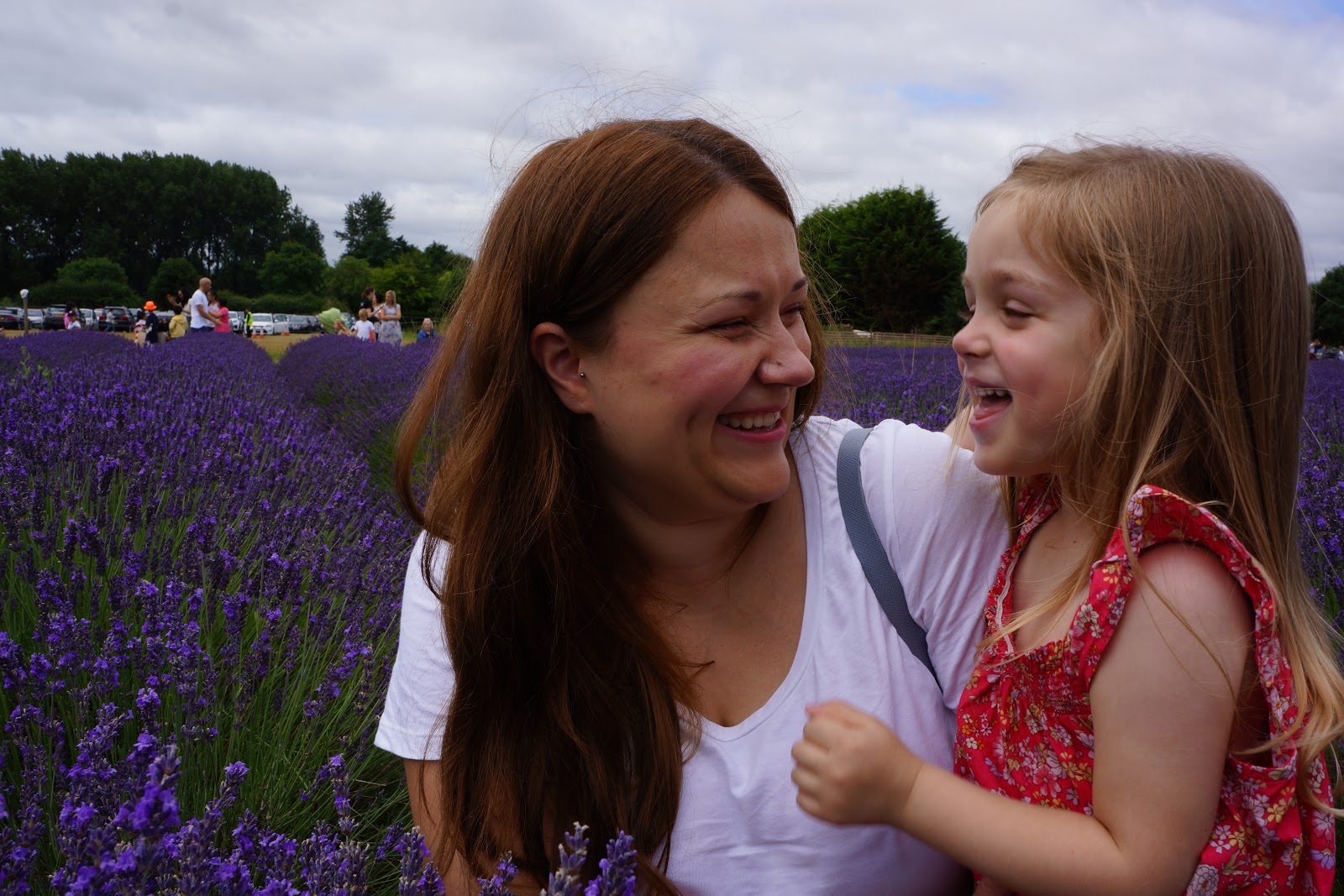mum and daughter laughing at a lavender field