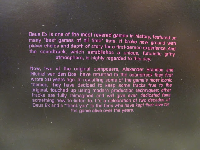 Photo of text in CD cover of Conspiravision: Deus Ex Remixed album