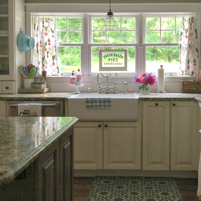 Summer kitchen window with farmhouse sink
