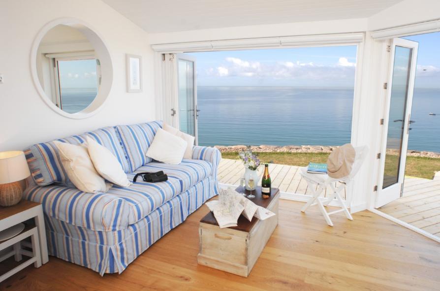casa-playa-salón-con-vistas