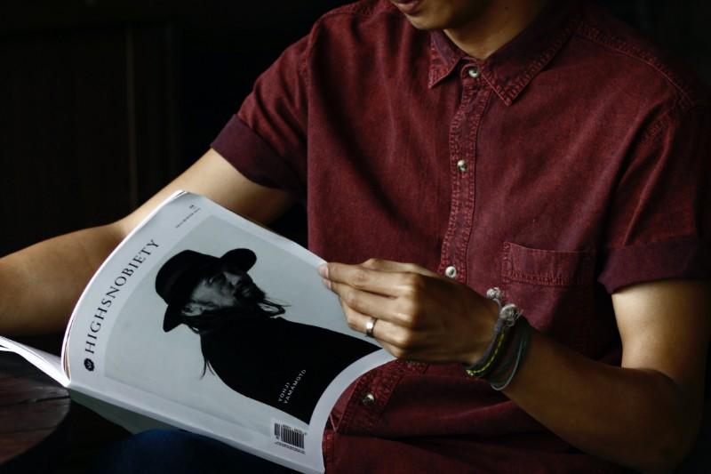 A man reading a magazine.