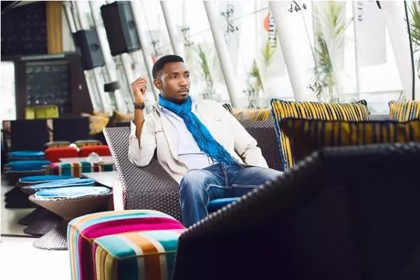Timi Dakolo blasts fan for his hate comment