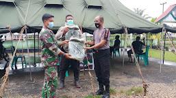 Jajaran Polres Tebo, Tetap Konsisten Membantu TNI AD Selesaikan Program TMMD ke-112