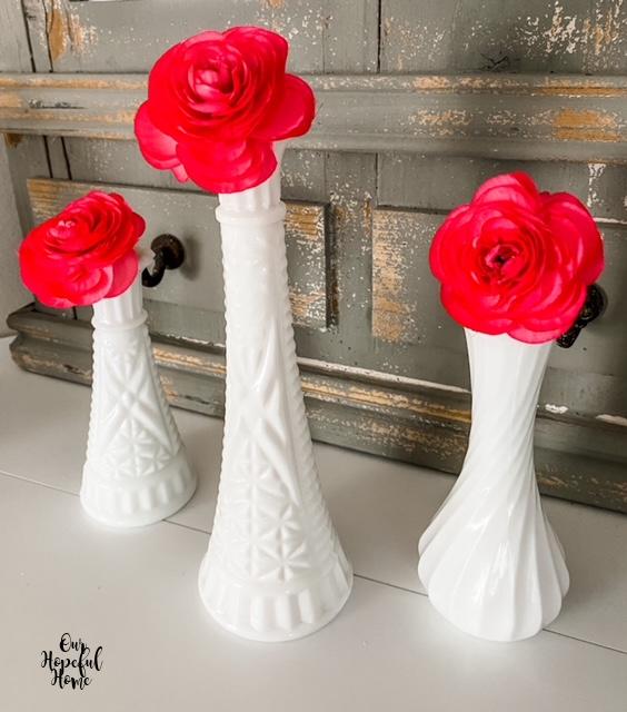 white bud vases pink flowers