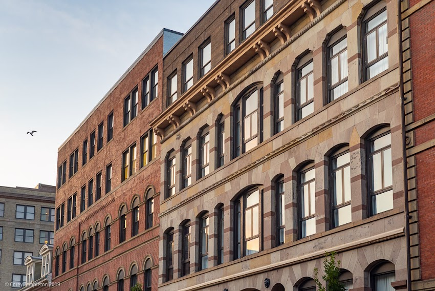 Portland, Maine USA August 2019 photo by Corey Templeton. That afternoon light on the buildings of Exchange Street.