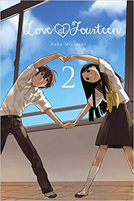 A teen boy and girl dancing in front of a classroom window, their arms align to form a heart