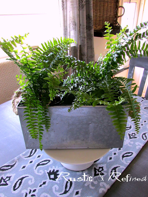 Galvanized metal centerpiece in a spring kitchen tour