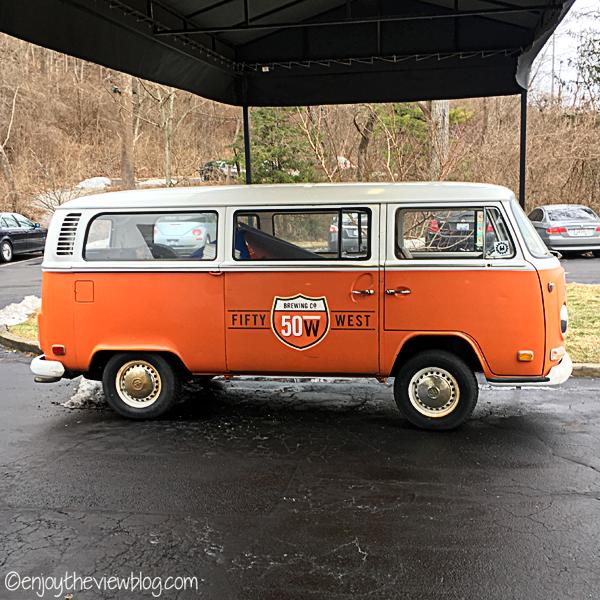 orange and white Fifty West Volkswagen van