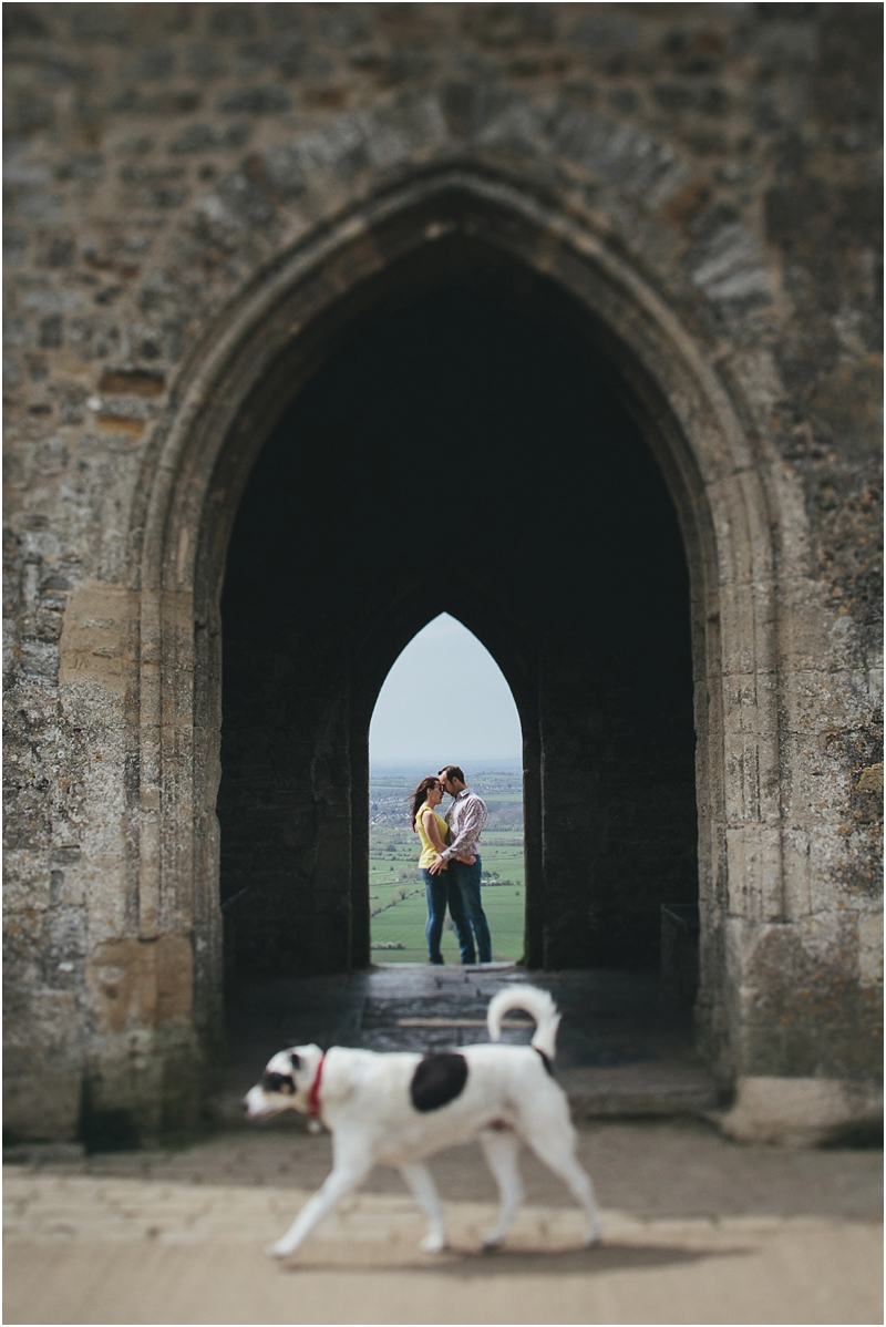 A couple kissing at Glastonbury Tor