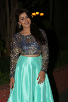 Nikki Galrani in Green Skirt  Top at Marakathamani music launch ~  Exclusive (28).JPG