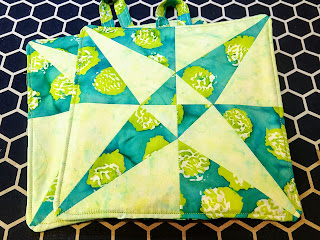 accuquilt crossed canoe potholders