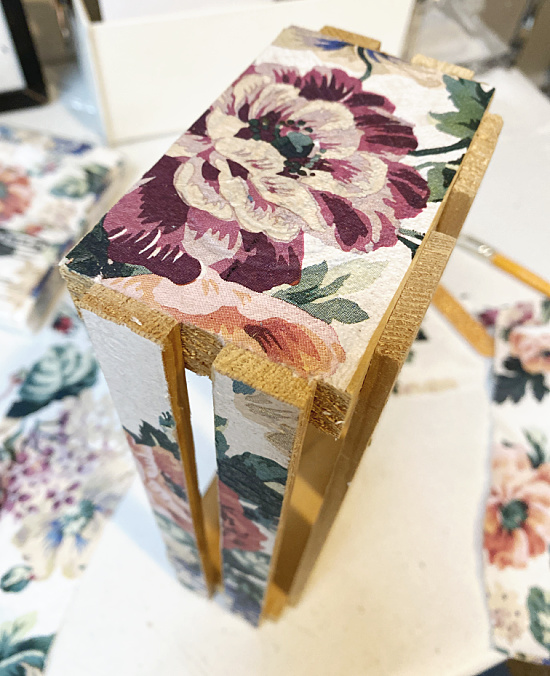 end of wooden crate with napkin decoupaged