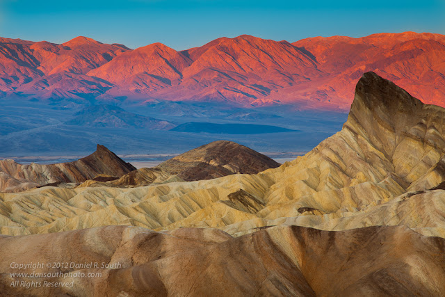 a photo of a Red Glow on the Panamint Mountains from Zabriskie Point at Daybreak