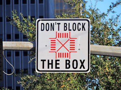 "Traffic control signage: ""Don't Block the Box"""