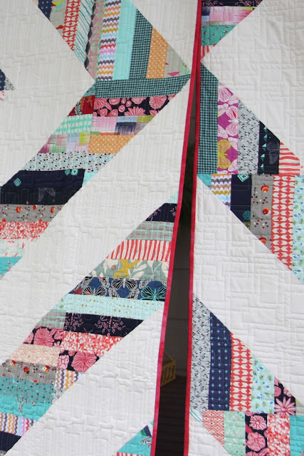 Two Modern Barn Raising quilts from Fons & Porter's Quilting Quickly-close up of quilting