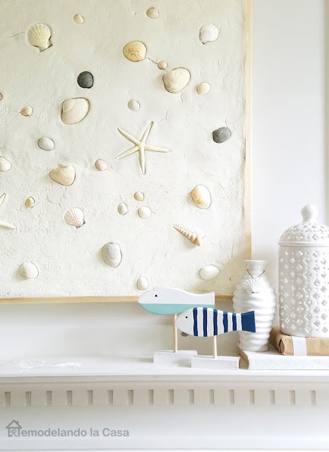 sUMMER MANTEL WITH SEA SHELLS WALL ART AND FISH SCULPTURES
