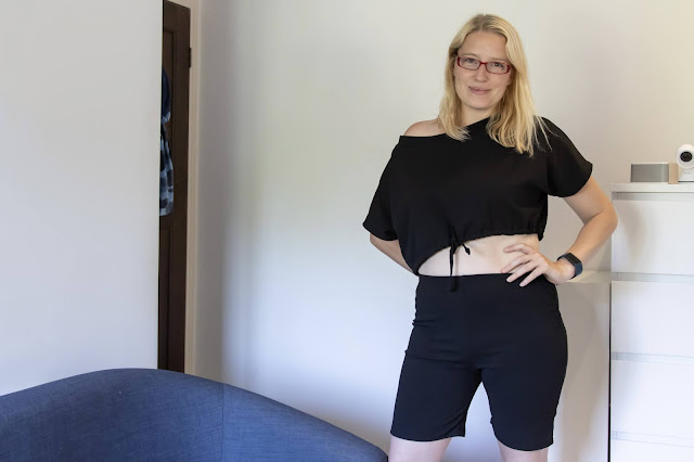 Posing in black crop top and cycling shorts