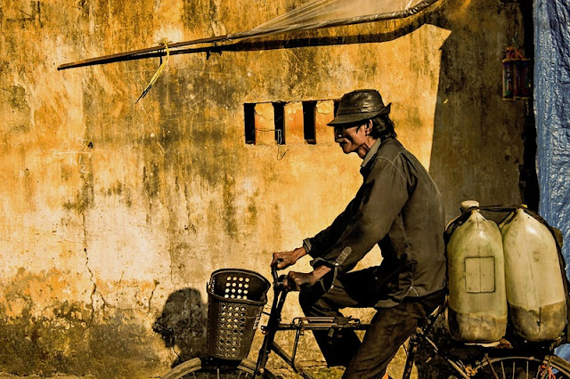 Photographs of Hoi An by photographer Réhahn in top Travel Magazine in UK
