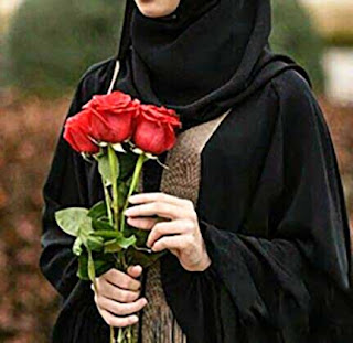 تنزيل صور ورد رائعة ، صور ورد احمر تحمله فتاة جميلة بفستان اسود