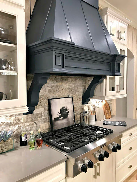 Dark blue vent hood white kitchen