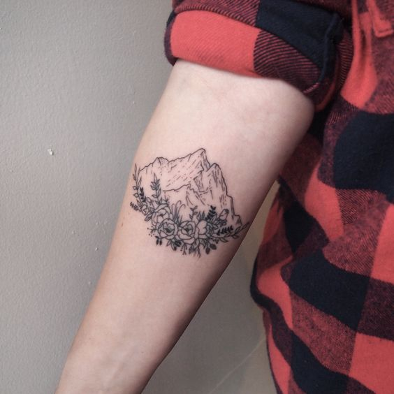Stunning Arm Mountain & Flower Tattoos