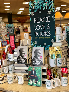 Barack Obama book display featuring mugs and books