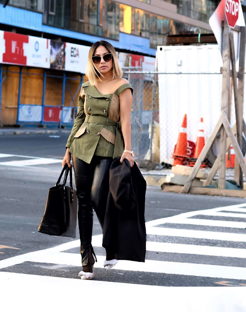 Army green top paired with a faux leather pants