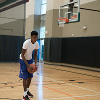 Photo of Adonis working out on basketball court.