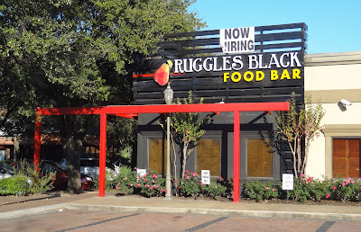 """Ruggles Black Food Bar with """"NOW HIRING"""" banner on Kirby Drive store front"""