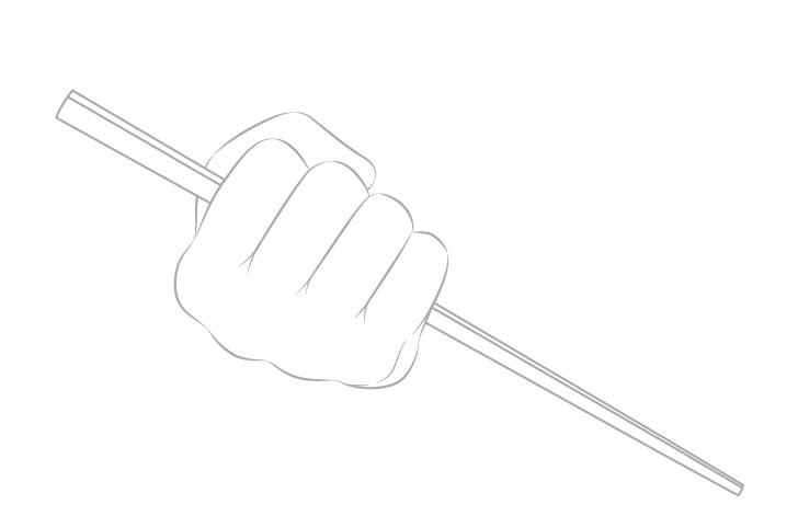 Tangan memegang sumpit dalam gambar garis kepalan tangan