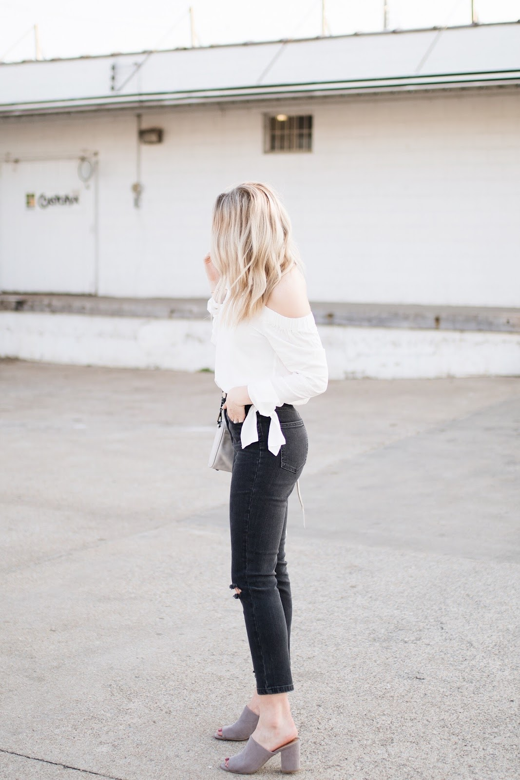 white blouse, black high-waisted jeans