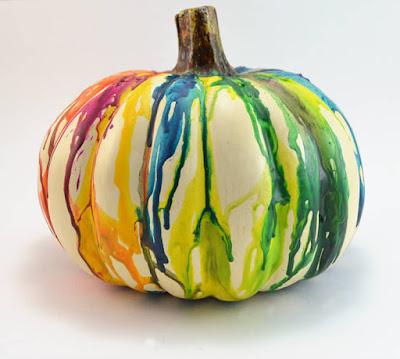 http://www.dreamalittlebigger.com/post/melted-crayon-pumpkin-craft.html