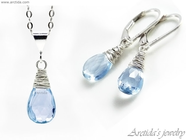 https://shop.arctida.com/en/home/51-20-sky-blue-topaz-necklace-and-earrings-set-in-sterling-silver-nimue.html#/28-jewelry_sets-earrings_necklace