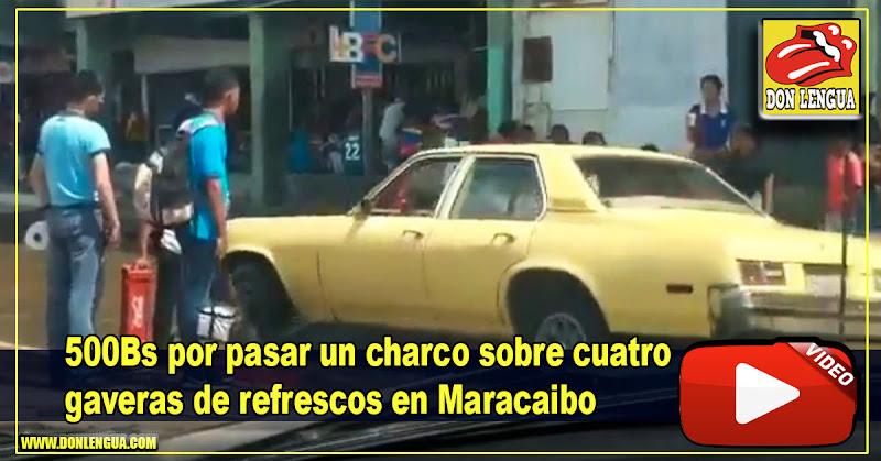500Bs por pasar un charco sobre cuatro gaveras de refrescos en Maracaibo