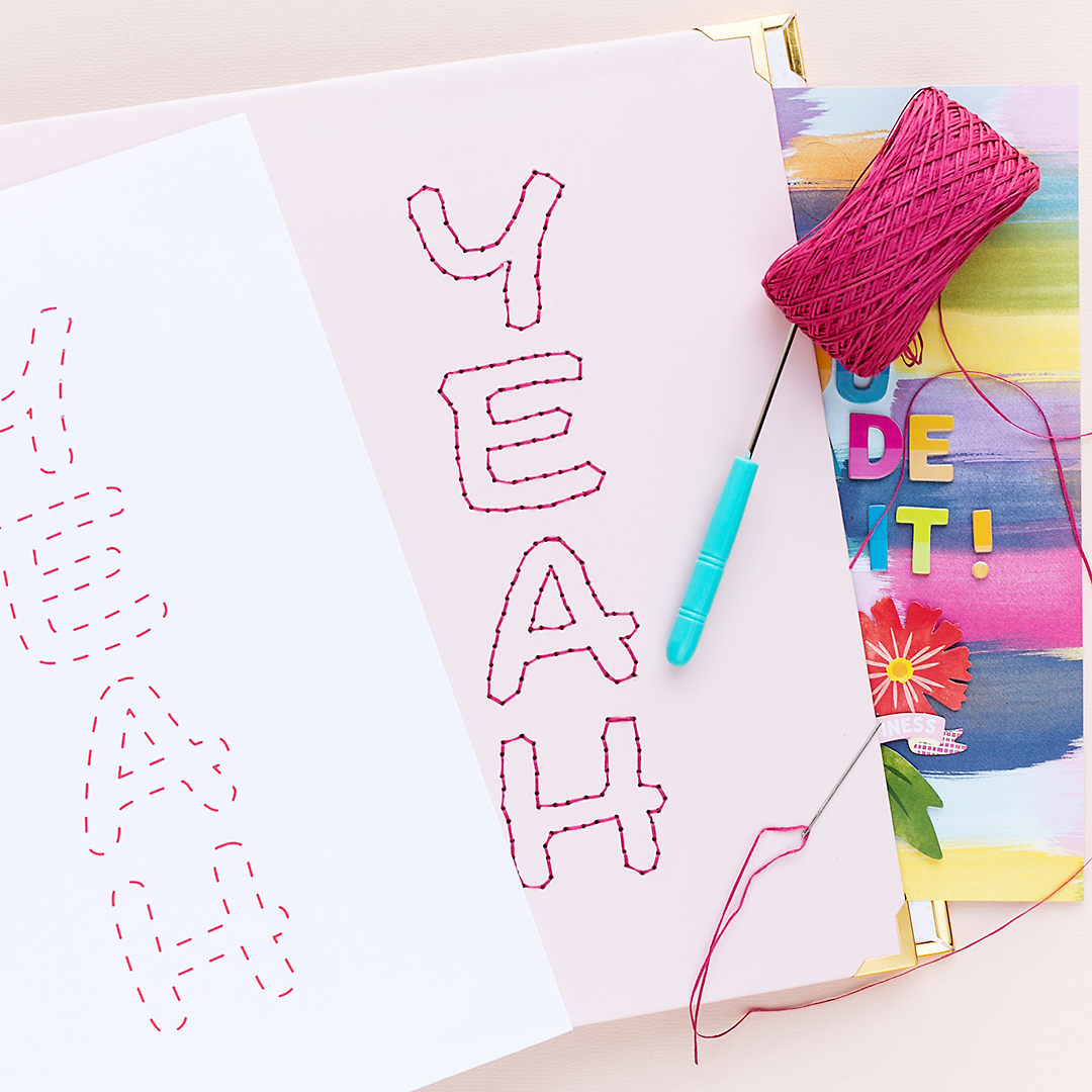 Decorate the cover of a paper wrapped album by We R Memory Keepers with yarn
