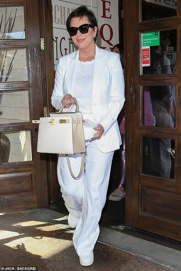 Kris Jenner is magical in monochrome as she lunches in an all white ensemble
