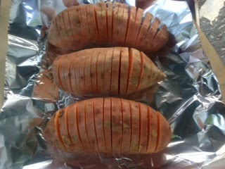 sweet potatoes sliced on cookie sheet