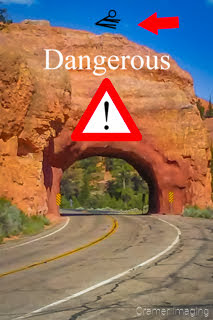 Graphic of a Red Canyon arch tunnel with a red arrow pointing to a stuntman graphic the top of the structure with a danger warning in Utah