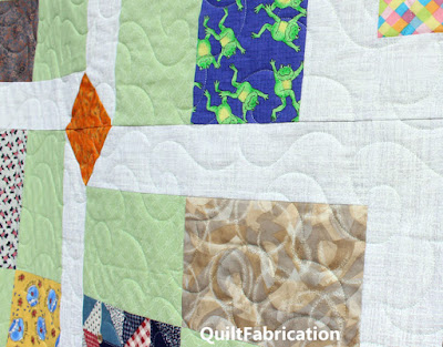 print fabrics with a light green fabric for a quilt