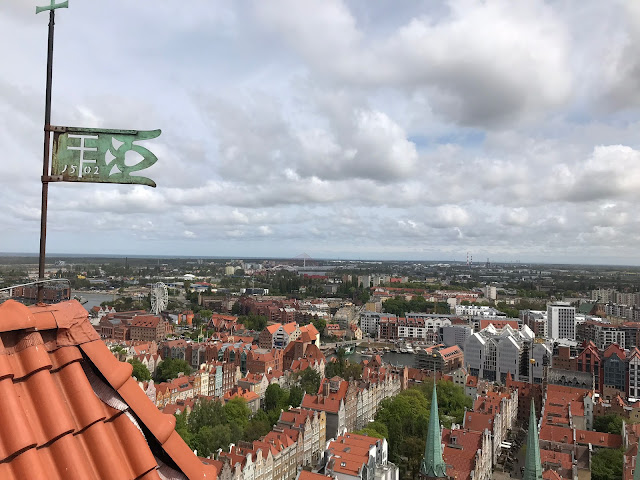 view of rooftops in gdansk under a cloudy sky