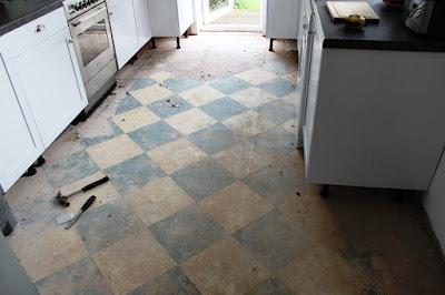 Exposing the very old kitchen floor tiles