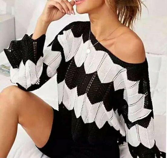 Πλεκτό μπλουζάκι ριγέ λευκό-μαύρο.