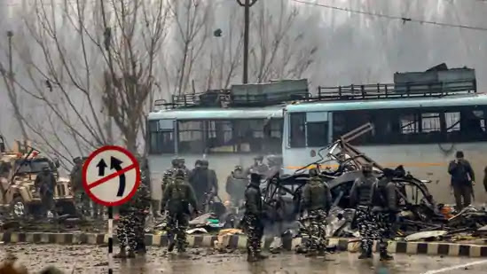 Security personnel carry out the rescue and relief works at the site of suicide bomb attack at Lathepora Awantipora in Pulwama