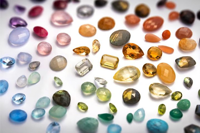 A photo of different colored gemstones.