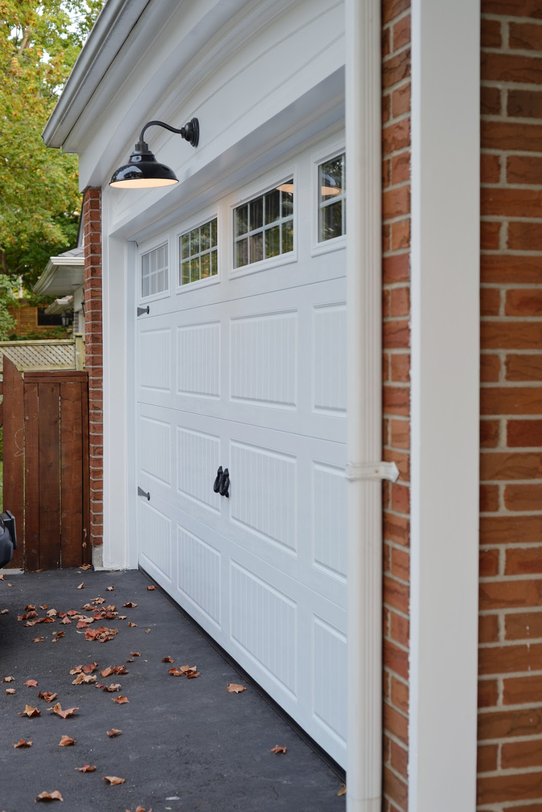 carriage house style garage door with Rejuvenation barn light