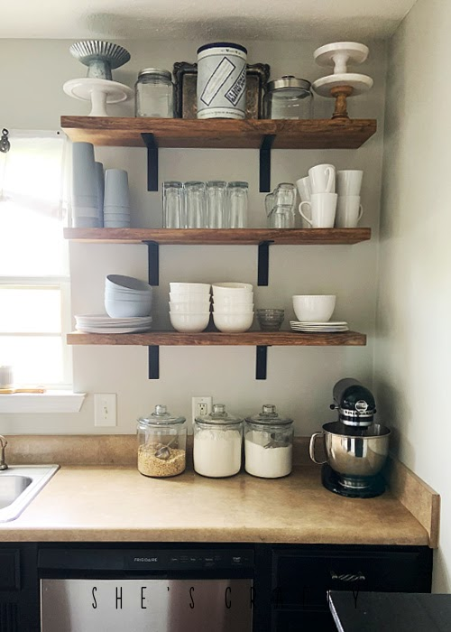 Open Shelves in kitchen holding every day dishes.