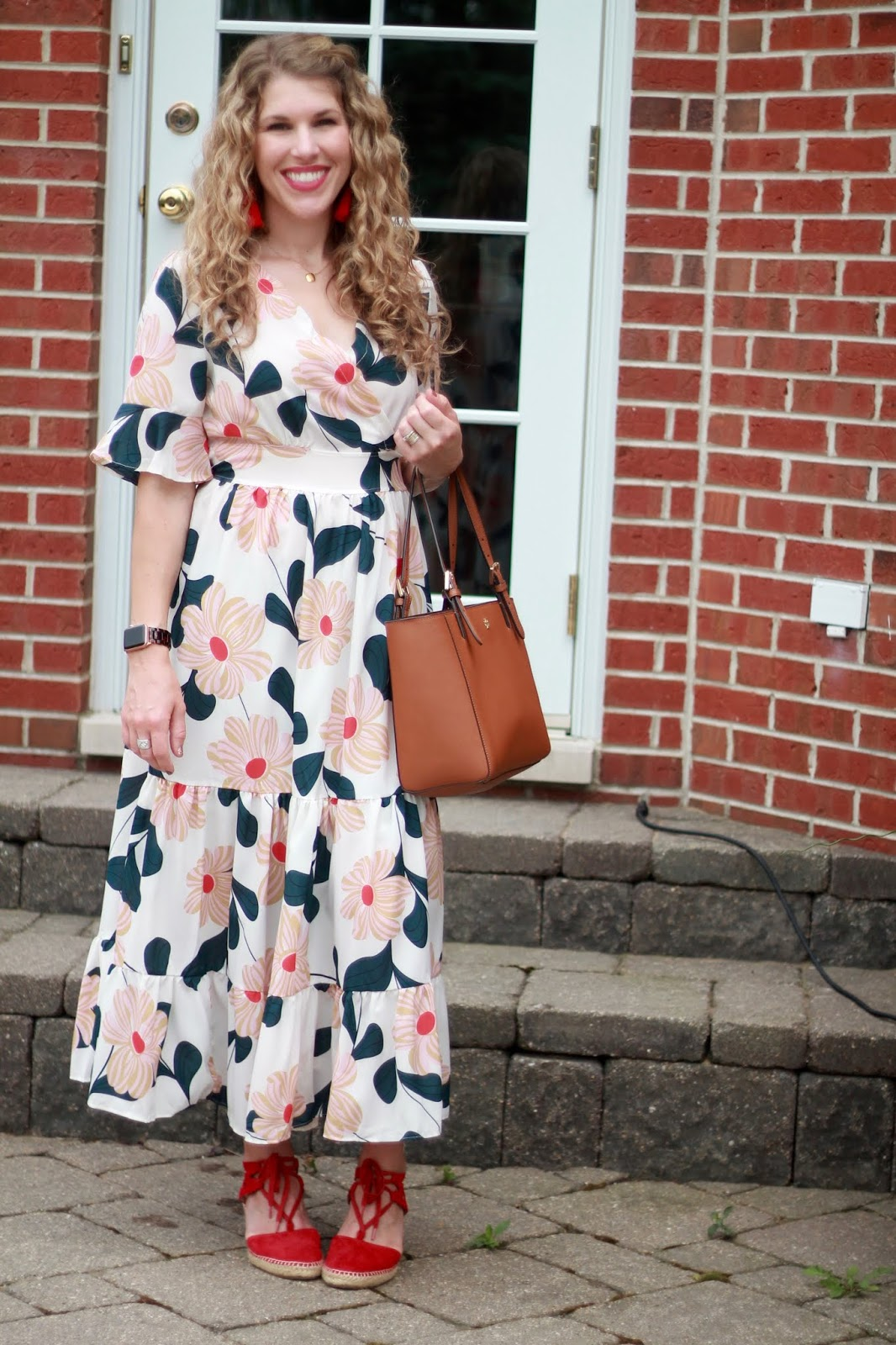 white floral ruffle midi dress, red espadrilles, cognac Tory Burch tote, red tassel earrings,