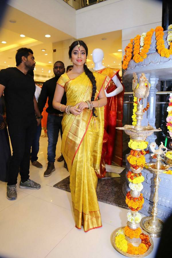 Indian Actress Shriya Saran Long Hair In Traditional Yellow Saree At Showroom Launch