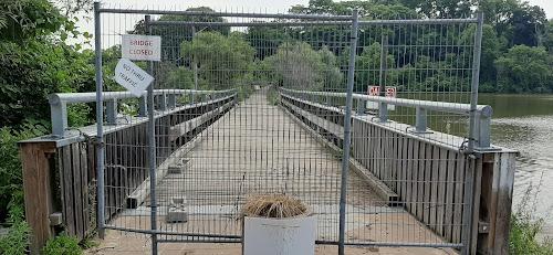 Fence blocking access to Valley Inn Road pedestrian bridge